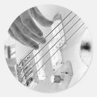 Bass player , bass and hand, negative image classic round sticker