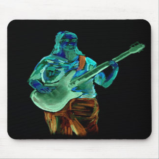 Bass player, done in neon colors on black back mouse pads