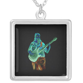 Bass player, done in neon colors on black back silver plated necklace