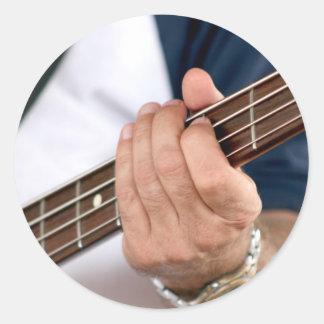 bass player hand on neck male photograph.jpg sticker