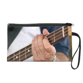 bass player hand on neck male photograph.jpg wristlet purse