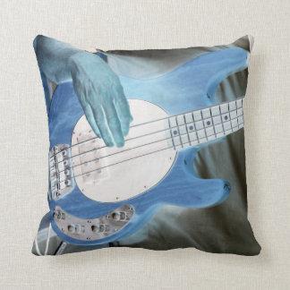 bass player invert four string bass hands drummer throw pillows