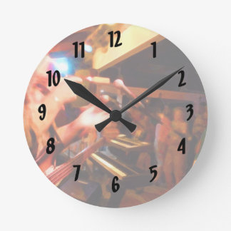 bass player playing jawbone crowd colorful paintin round clock
