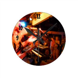 bass player playing jawbone crowd colorful paintin round clock