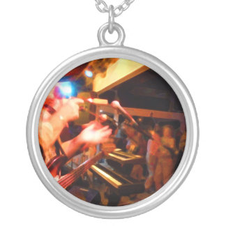 bass player playing jawbone crowd colorful paintin round pendant necklace