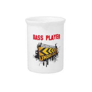bass player under construction drink pitchers