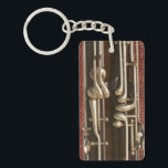 """Bassoon Keys on Dark Red Keychain<br><div class=""""desc"""">A key chain featuring keys: of the bassoon variety, in close-up detail. Their burnished silver metal contrasts vividly with the rich, dark wood of the instrument itself, and when seen this way - without the rest - seems to take on a new visual meaning (not to mention the irresistible pun)....</div>"""