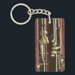 "Bassoon Keys on Dark Red Keychain<br><div class=""desc"">A key chain featuring keys: of the bassoon variety, in close-up detail. Their burnished silver metal contrasts vividly with the rich, dark wood of the instrument itself, and when seen this way - without the rest - seems to take on a new visual meaning (not to mention the irresistible pun)....</div>"