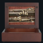 "Bassoon Keys on Dark Red Memory Box<br><div class=""desc"">The burnished metal keys of a beautiful old bassoon contrast vividly with the rich, dark wood; one section of this double reed instrument is displayed against a backdrop of a burgundy-colored pattern, nicely framed by the edges of this stylish wooden keepsake box. Same image inside and out — just the...</div>"