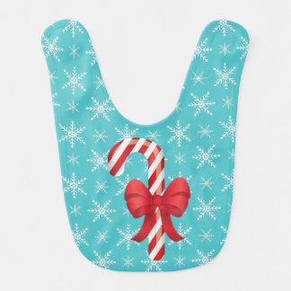 Bastón de caramelo festivo del navidad con un arco baberos para bebé