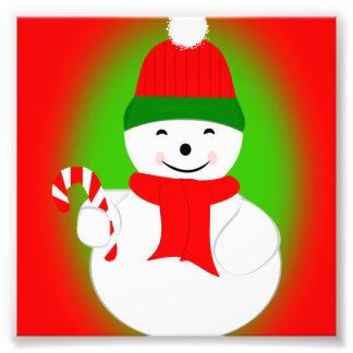 Bastón del muñeco de nieve y de caramelo fotos