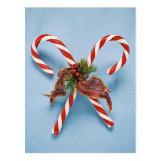 Bastones de caramelo con acebo tarjetas postales
