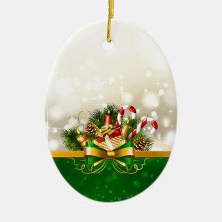 Bastones de caramelo con el arco adorno navideño ovalado de cerámica