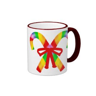 Bastones de caramelo del arco iris tazas