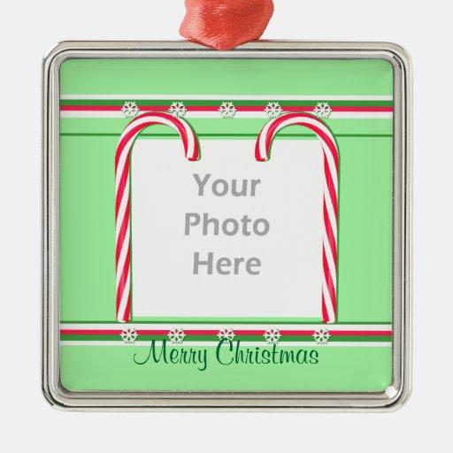 Bastones de caramelo del navidad en el verde (marc adornos