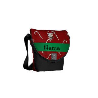 Bastones de caramelo rojos del perro conocido de e bolsas messenger