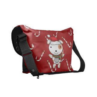 Bastones de caramelo rojos del perro conocido de e bolsas de mensajería