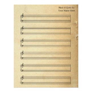Bastones en blanco del piano de la partitura del membrete personalizado