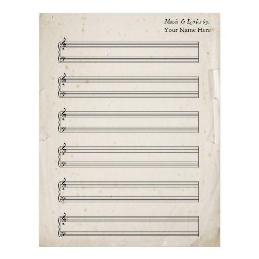Bastones rasgados viejos del piano de la partitura membrete