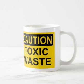 Basura tóxica de la precaución taza