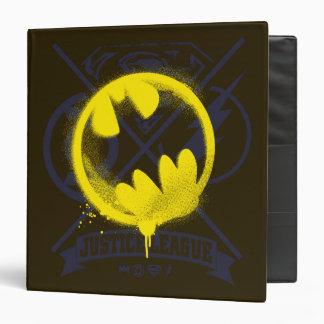 Bat Symbol Tagged Over Justice League Binder