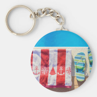 Bathing slippers and bath towel at swimming pool keychain