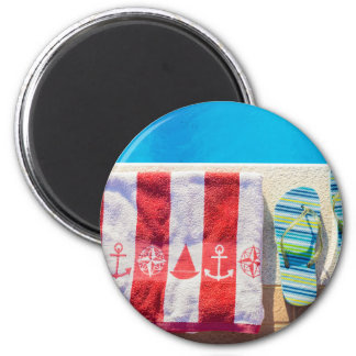 Bathing slippers and bath towel at swimming pool magnet