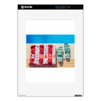 Bathing slippers and bath towel at swimming pool skin for the iPad