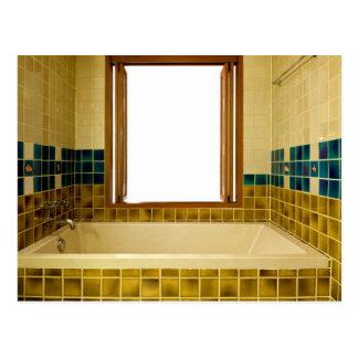 Bathroom with bathtub and open window postcard