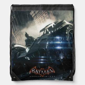 Batman con Batmobile en la lluvia Mochilas