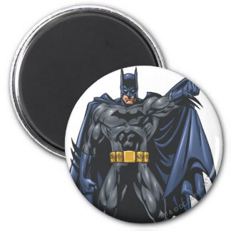 Batman holds up cape 2 inch round magnet