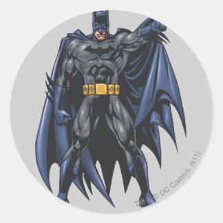 Batman holds up cape classic round sticker