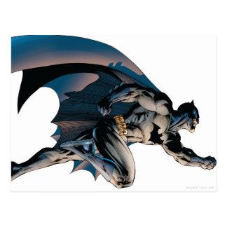 Batman que salta vista lateral postal