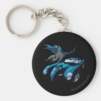 Batman swings over basic round button keychain