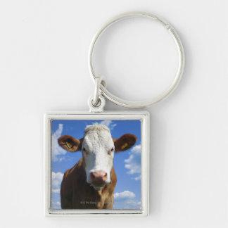 Bavarian cow against blue sky key chain