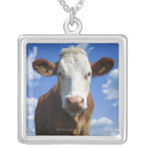 Bavarian cow against blue sky silver plated necklace
