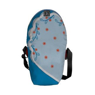 Bayas rojas en azul bolsas messenger