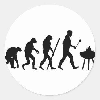 Bbq de la evolución del cocinero del cocinero etiqueta redonda
