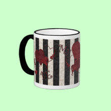 Be My Valentine Mug - Black and white stripes with pretty red hearts and the words 'Be My Valentine' Fill it with her/his favorite candies and top it off with a pretty bow. A perfect Valentins gift for your special someone!