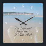 """Be Still and Know I AM GOD Scripture Psalm 46:10 Square Wall Clock<br><div class=""""desc"""">Beautiful wall clock features Bible Verse Psalm 46:10,  Be still and know I am God. The background is the amazing Obidos Lagoon in Foz do Arelho,  Portugal.</div>"""