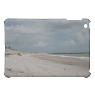 Beach and dune and jetty empty except one iPad mini case