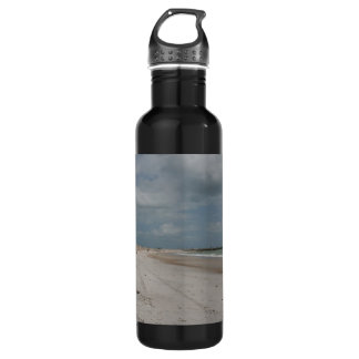 Beach and dune and jetty empty except one water bottle