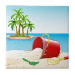 """Beach and ocean tile<br><div class=""""desc"""">Bucket on the sand near the ocean</div>"""