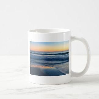 beach and waves at sunset coffee mug