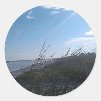 beach at sunset classic round sticker