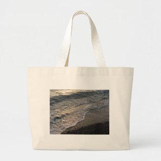 Beach at sunset large tote bag