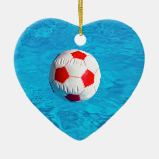 Beach ball floating  in blue swimming pool ceramic ornament