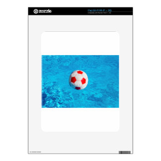 Beach ball floating  in blue swimming pool iPad decal