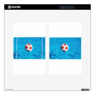 Beach ball floating  in blue swimming pool kindle fire skin