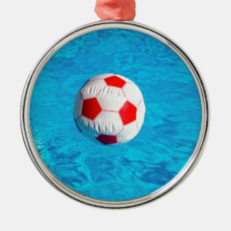 Beach ball floating  in blue swimming pool metal ornament